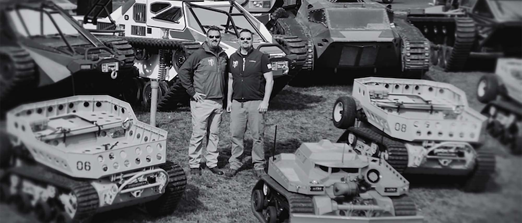 Howe Brothers surrounded by machines