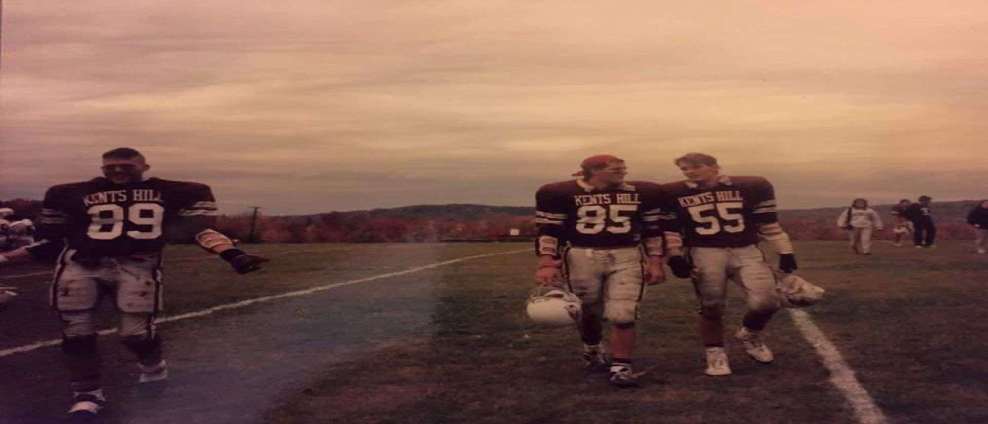 Howe brothers in football uniforms