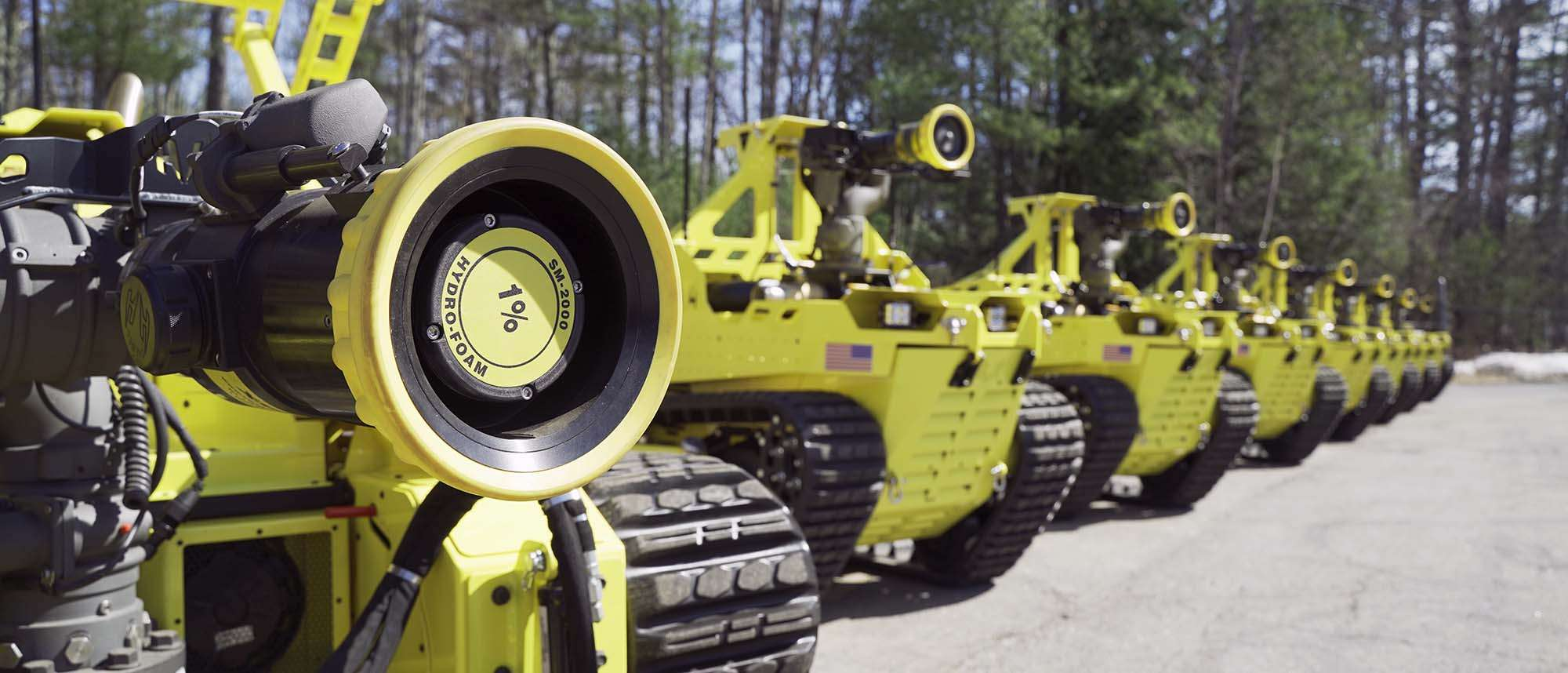 Yellow Thermite vehicles lined up in  a row outside