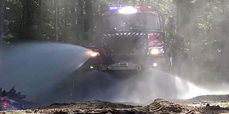 Thermite spraying water in woods