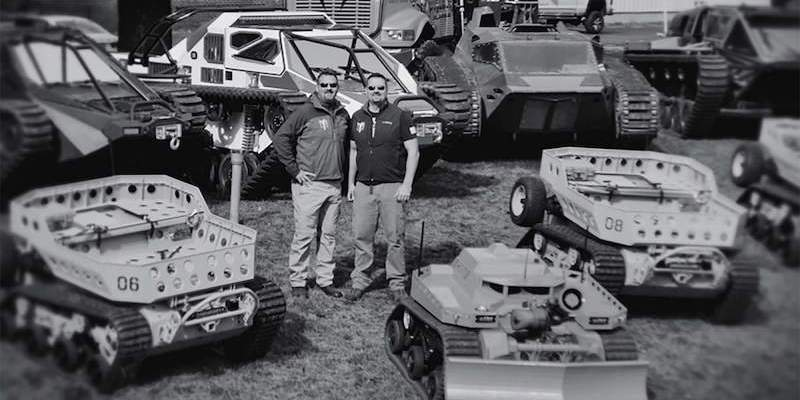 Howe Brothers surrounded by machinery